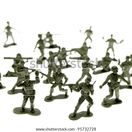 Toy soldiers on plain background - stock photo
