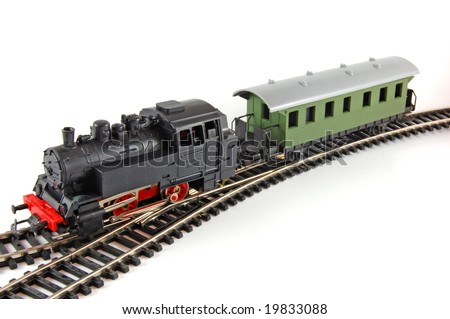 Toy Steam Train and caboose - stock photo