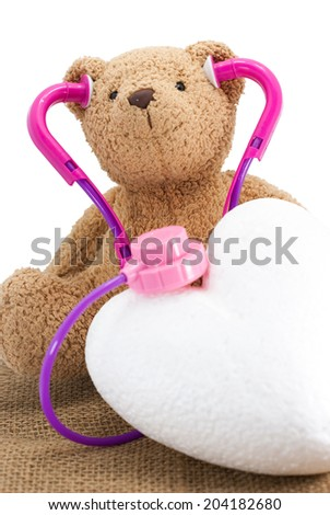 Toy Stethoscope with doll - stock photo