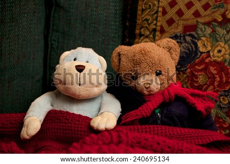 Toy Teddy Bear and Monkey Sitting Together as Friends Friendship - stock photo