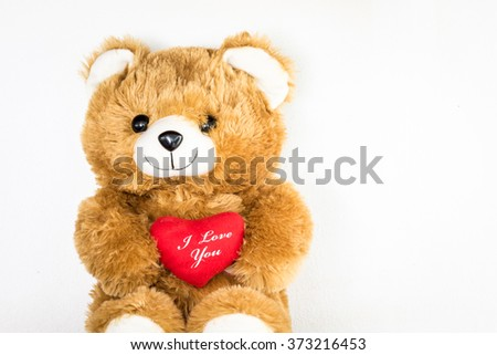 Toy teddy bear on white background