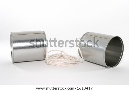 Toy telehones made out of tin cans and a string - stock photo