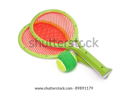 Toy tennis racket and ball - stock photo