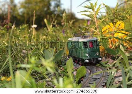 toy train at sunset - stock photo