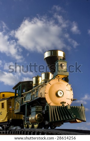 Toy train with clouds in background - stock photo