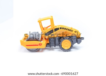 Toy Truck Drum Compactor Road Roller Vehicles Close Up Industrial Car Machine Doing Construction on White Background