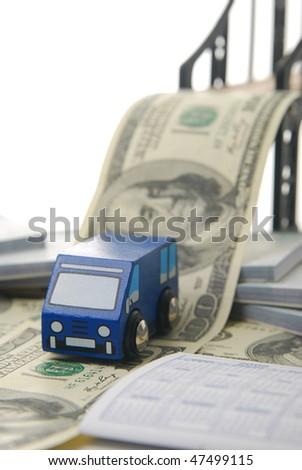 toy van driving off money bridge focus on van. - stock photo