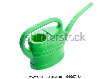Toy watering can made from green plastic for children use. Studio shot, isolated on white background.