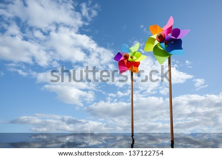 Toy windmill concept of green energy wind farm at sea - stock photo