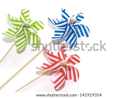 Toy windmills on white background (3) - stock photo