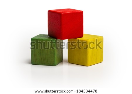 toy wooden blocks stack, pyramid of blank multicolor box cube over white background  - stock photo