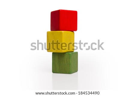 toy wooden blocks stack, tower of blank multicolor box cube over white background - stock photo