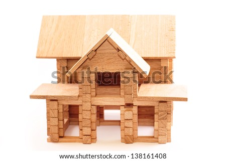Toy wooden house isolated on white background. Building, construction concept.