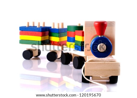 Toy wooden train with reflection on white background - stock photo