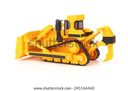 Toy yellow bulldozer on a white background - stock photo