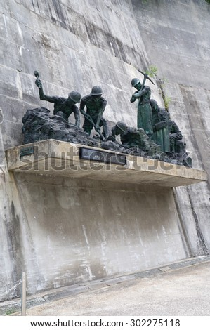 Toyama, Japan - July 30, 2015: Cenotaph of Kurobe Daiyon Dam in Tateyama Kurobe Alpine Route. This route is the famous mountain sightseeing route between Toyama and Nagano, Japan.