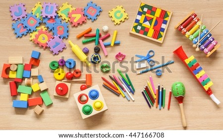 Toys and stationery for kids to play and learn - stock photo