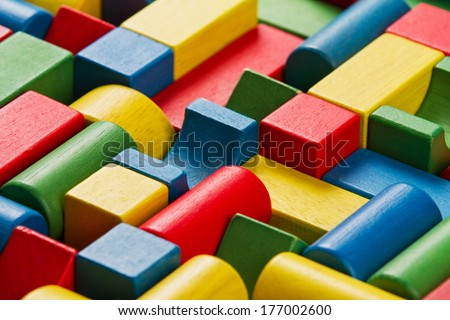 Toys blocks, multicolor wooden bricks, group of colorful building game pieces  - stock photo
