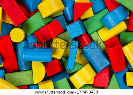 Toys blocks, multicolor wooden building bricks, heap of colorful game pieces - stock photo