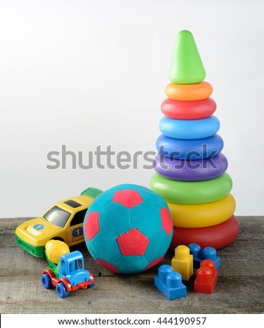 toys collectionon wooden table and white background