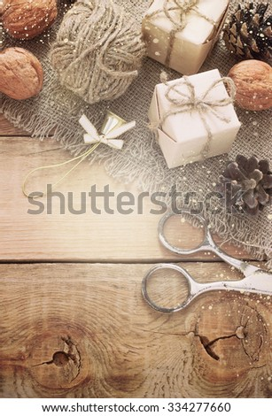 toys for the Christmas tree , gift, Walnut, pine cones on old wooden background.Christmas. Christmas time. Pine cones   Wooden background. toning