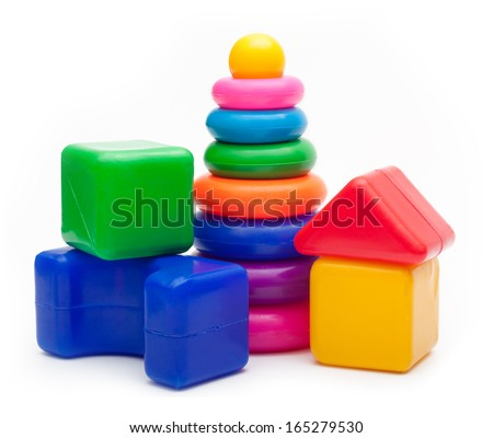 Toys  isolated on white background. Pyramid build from colored rings and a building blocks. - stock photo