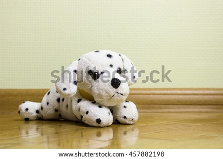 Toys, kids, childhood. Toys, kids, child at home interior. Teddy  toy dog sitting alone on a floor. Copy space. Studio shot at home background. - stock photo