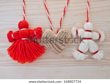 Toys made of red and white threads. Boys girl hold heart. Idea of Valentine's Day - stock photo