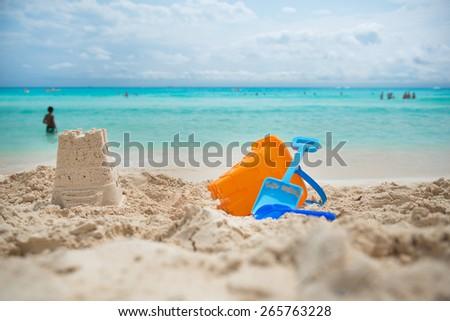 Toys on a sandy beach - stock photo