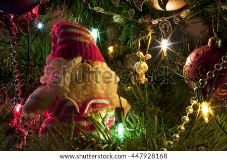 Toys on the xmas tree. Holiday greeting card for the New Year or Christmas. - stock photo
