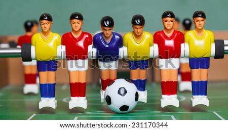 Toys players. foosball. soccer ball - stock photo