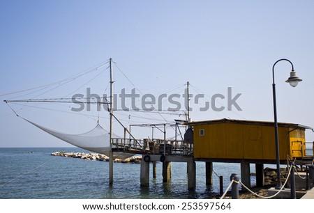 Trabucco is an old fishing machine typical of the Italian Adriatic Sea coast - stock photo