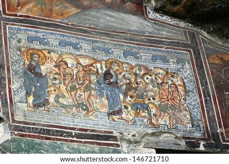 TRABZON, TURKEY-AUG 4:Vandalized Greek Orthodox fresco of Adam and Even at Sumela Monastery dating from the 4th c. is currently undergoing restoration at Sumela near Trabzon, Turkey on August 4, 2011. - stock photo