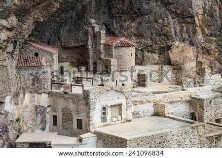 TRABZON, TURKEY - JUNE 19, 2013: Tourists visit Sumela Monastery on June 19, 2013 in Trabzon,Turkey. Sumela is 1600 year old ancient Orthodox monastery. - stock photo