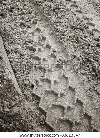 trace in the sand - stock photo