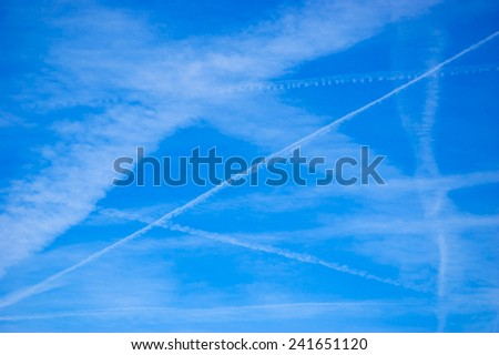 Trace of plane in the sky. Abstract background. - stock photo