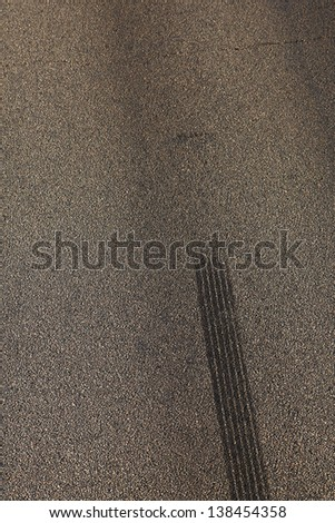 Traces from tires on an asphalt covering - stock photo
