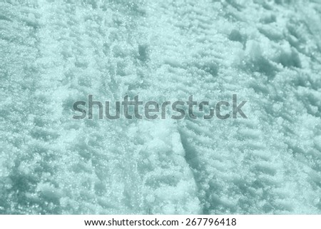 traces of the car in the snow - stock photo