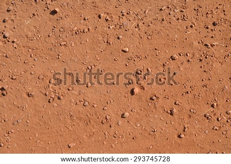 Traces of the shoe on the ground. Red background of the Earth - stock photo