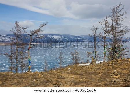 Traces of tourists on the island Ogoy - stock photo