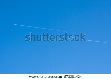 traces of two aircraft in the blue sky