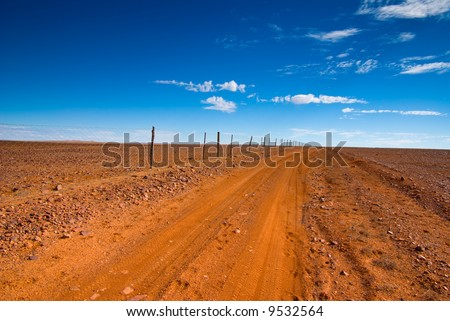 Track along The Dog Fence near Coober Pedy in outback South Australia - stock photo