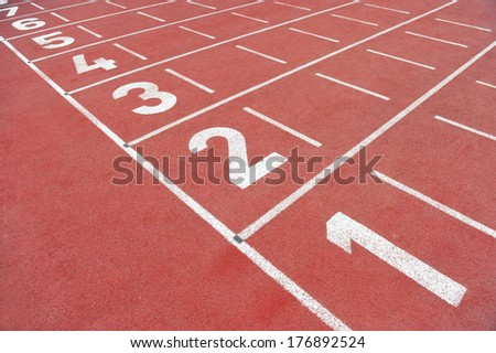 Track and field sprint finish line with no people - stock photo