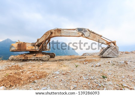 track damage excavator awaiting for repair at mining site