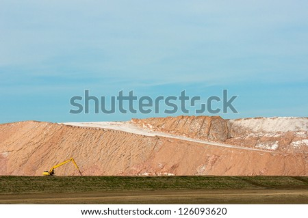Track hoe at Potash Tailing Hill - stock photo
