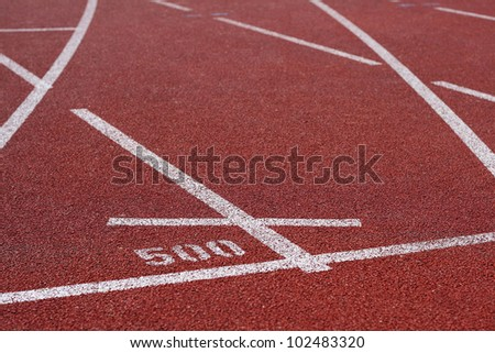 Track lanes ins sports runway, red surface