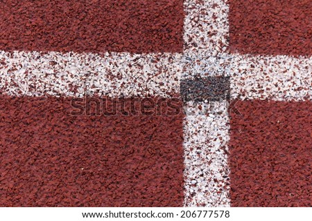 Track red and white lines divide the box for the tournament. - stock photo