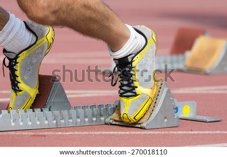 Track runner ready to go into a career - stock photo