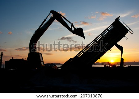 track-type loader excavator machine doing earthmoving