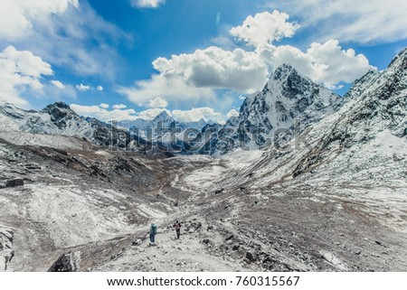 Tracker trail in Khumbu valley, Himalayan ridge. Mountain trails among the snow-capped peaks of the Himalayan mountains.
